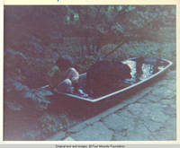 John, Jr. and Sadie in boat/pool, outside the white house along the lane