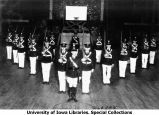 Drill team in formation with commander at center, The University of Iowa, 1930