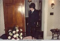 John, Jr. in door way of living room looking down