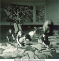 Students painting modern art wall hangings, The University of Iowa, March 4, 1940