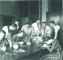 Students working on lab experiments, The University of Iowa, 1930s?