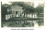 Women in Greek costume by mock Greek temple, City Park, The University of Iowa, 1915