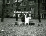 "Stange House's lawn display, """"Clean K-State"""", Homecoming, 1957"