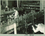 Students conducting chemistry experiments, The University of Iowa, 1930s?