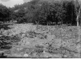 Flood waters carried boulders to where wash of hill emerges on small plain, Dorchester, Iowa, late 1890s or early 1900s