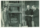 Officials in materials testing laboratory, The University of Iowa, 1937