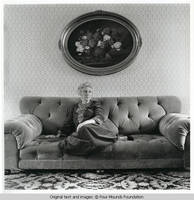 Elizabeth sitting on sofa
