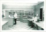 Students in pharmacy laboratory, The University of Iowa, December 1954