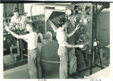 Adjusting levers and dials in Hydraulics laboratory, The University of Iowa, August 15, 1948