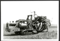 Gilbert Wehrman Leans Against a Tilling Machine