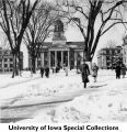 Pedestrians on a snowy Pentacrest, The University of Iowa, March 1948