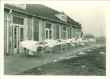 Children sunning in beds on the veranda at the Children's Hospital, The University of Iowa, January 1923