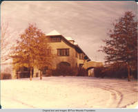 View of Grey house and car port in Winter