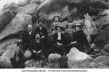 People on granite boulders, Overland Hill, Iowa, late 1890s or early 1900s