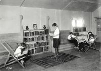 Children reading at a library extension site.