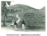 Women walking near terrace, China, 1944