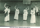 Dancers in Greek costumes in a gymnasium, The University of Iowa, 1920s
