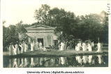 Women in Greek costume posed in front of mock Greek temple at City Park, The University of Iowa, 1915