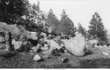 Boulders of disintegration showing effects of weathering on granite, between Loveland and Estes Park, Colorado, late 1890s or early 1900s.