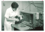 Lab worker with test rat, The University of Iowa, 1960s