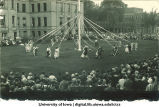 Women in costume dancing with a maypole on the Pentacrest lawn, The University of Iowa, June 1924