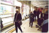 Louise Noun wearing a hard hat at the Grinnell College Arts Building, Grinnell, Iowa, May, 1998