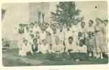 Women and children posed outdoors, Thorpe, Iowa, 1917