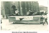 Canoe on Mecca Day parade float, The University of Iowa, 1921