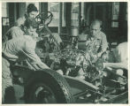 Engineering students working on automobile engine in engineering laboratory, The University of Iowa, 1939