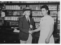 Ernest Duprez and Leonard Duprez at Mining Camp Store