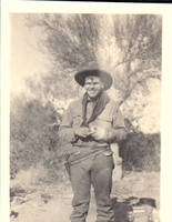 Unknown man wearing cowboy outfit