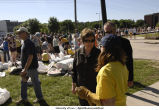University President Sally Mason talks with sandbagging volunteers, The University of Iowa, June 13, 2008