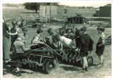 First graders with farm equipment, The University of Iowa, May 15, 1939
