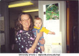 Carolyn Lara-Braud holding Erick Fletcher, The University of Iowa, June 5, 1998