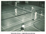 Courts of badminton in a gymnasium with line judges, The University of Iowa, 1938