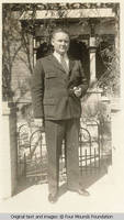 Milton Kirch in suit with pipe