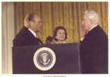 Chief Justice Warren Burger swearing in Pres. Gerald Ford, with Betty Ford looking on, Washington, D.C., August 9, 1974