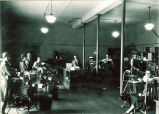 Journalism students with printing presses in Close Hall, The University of Iowa, 1920s