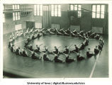 Students in gymnasium doing calisthenics, The University of Iowa, 1930