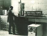 Student in chemistry laboratory, The University of Iowa, 1920s