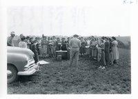 Harlon Backhaus presenting to teachers on V.W. farm, 1950