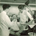 Dental students working with a patient, The University of Iowa, 1940s
