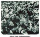 Spectators in bleachers, The University of Iowa, 1920s?
