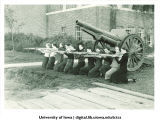 Women's rifle team in front of cannon, The University of Iowa, October 27, 1936