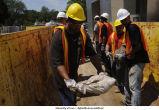 Workers remove sandbags outside Iowa Advanced Technology Laboraties, The University of Iowa, July 9, 2008