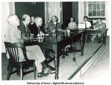 Alumni speaking at microphone, The University of Iowa, 1950s