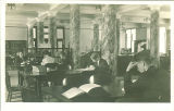 Studying in a Macbride Hall library, the University of Iowa, 1910s?