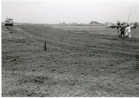 Bulldozed field with water drainage pipes
