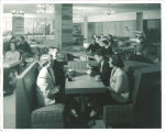 Talking in the Gold Feather Lounge in the Iowa Memorial Union, the University of Iowa, 1950s?