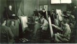 Students painting a portrait of a woman model in the Art Building, The University of Iowa, 1930s